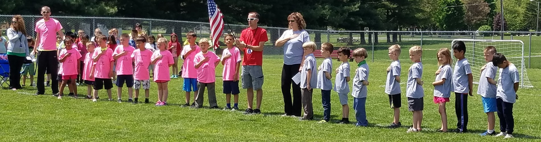 Mr. Shepherd's and Mrs. Garner's teams join in for the singing of the National Anthem prior to the start of the championship game.