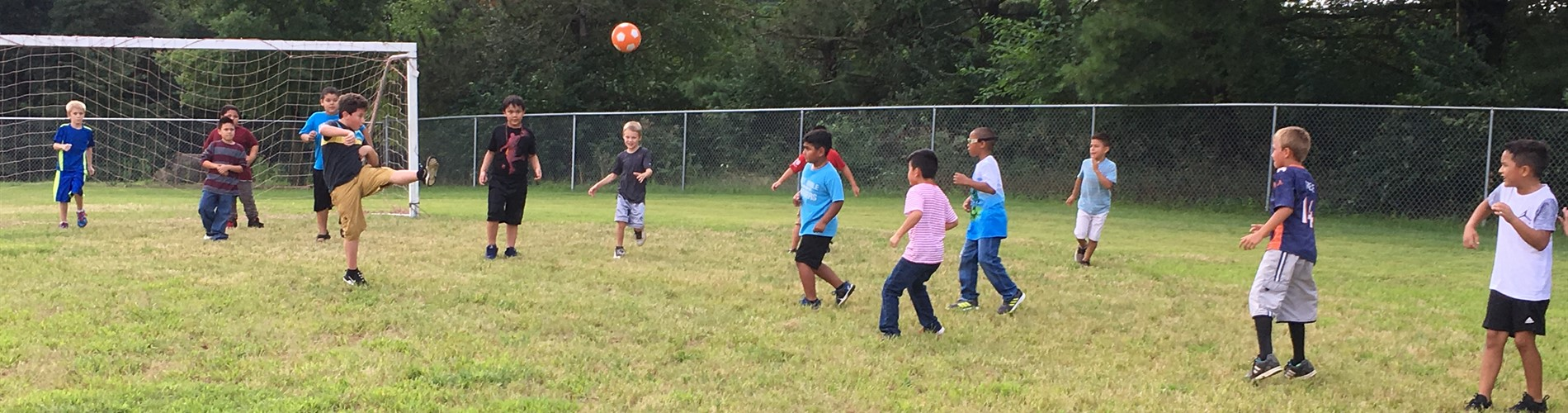 WNE students play soccer.