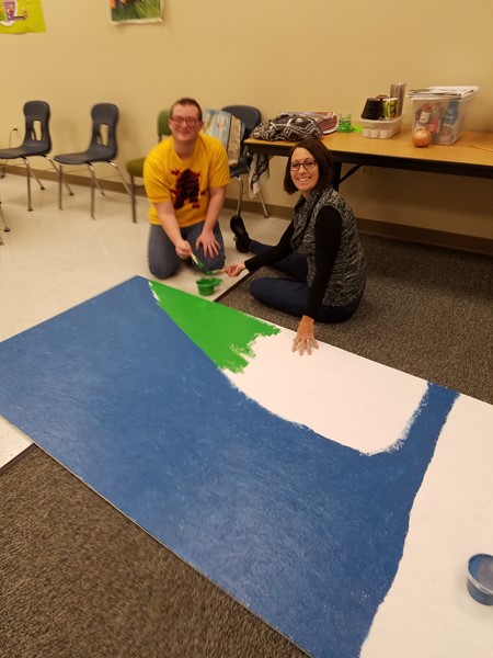 Painting a board for the Kendallville Parks and Recreation drive-through Christmas Card Greeting.