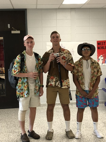 Three guys dressed as tourists for homecoming.