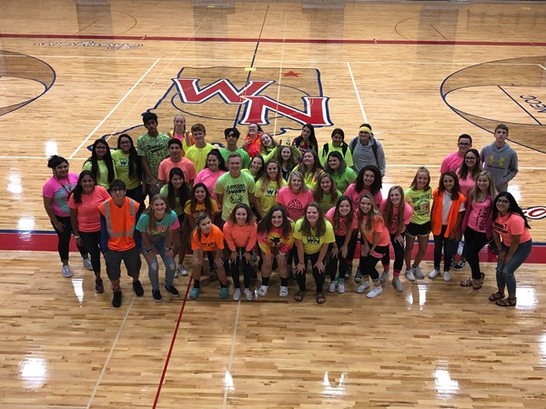 Sophomores dressed in neon colors for Color Block Day.