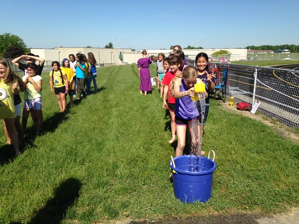 Students cool off with water games at Track and Field Day.