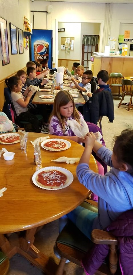 First graders practice sequencing while making pizzas at Vinee's Pizza.